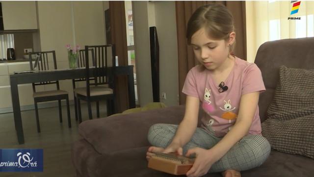 Povestea unei fetițe de șapte ani care cântă la Kalimba
